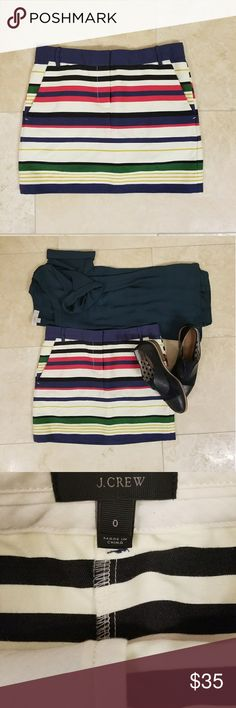 J. Crew Multicolored Striped Mini Skirt, Size 0 This J Crew mini skirt is ready to go on vacation with you. It's the perfect piece to dress up a basic tank top and sandals. Add a sun hat and you're ready to go!! Plus, the pockets are extra handy for everything from your phone to collecting shells on the beach.   Like new condition - never worn. J. Crew Skirts Mini
