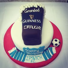 A guiness and football themed cake. The top tier is a chocolate guinness sponge and the bottom is a fruit cake.