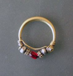 Size Diameter Region Gujarat, India Type nath Material gold, silver, glass Condition very good Description Ethnic Jewelry, Indian Jewelry, Beaded Jewelry, Silver Jewelry, Nath Nose Ring, Nose Rings, Nose Jewelry, African Beads, Jewelry Patterns