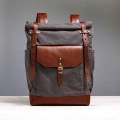 Waterproof waxed canvas backpack with roll top closure. Navy blue waxed canvas and tan leather. Waxed Canvas Bag, Canvas Backpack, Travel Backpack, Canvas Leather, Unique Backpacks, Top Backpacks, Crazy Horse, Thick Leather, Natural Leather