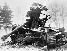 The Battle of the Bulge, Hitler's last stand on the Western front, began on Dec 16, 1944. Defending American troops fought a bitter month-plus-long battle to stop the Germans. Here, a German tank is finished by direct antitank fire.