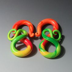 Gauged earrings, your size plugs, Snap Dragon. Polymer clay, spiral dangle plugs for stretched ears, orange,green,yellow..