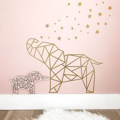 Wall stickers for a cool or sweet girl's room - the photo shows the geometric wall sticker of the elephant and the star wall stickers.