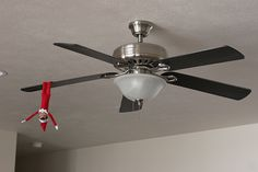 Elf on the Shelf idea - on a fan