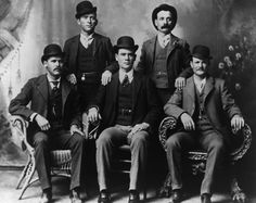 Portrait of the American outlaw gang The Wild Bunch, Texas. From left to right, standing: William Carver, Harvey 'Kid Curry' Logan. Seated: Harry 'Sundance Kid' Langbaugh (1870 - 1909), Ben 'The Tall Texan' Kilpatrick, Robert LeRoy 'Butch Cassidy' Parker (1866 - 1909). From the original photograph by John Swartz.