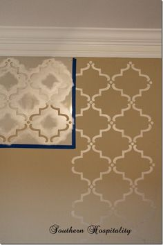 Stenciled Wall - Royal Design Studio's Large Moorish Stencil.  We mixed 2 paints together from Folk Art, Champagne and a creamy pearl, which I don't have the name of at the moment, but a basic ivory.  Both are pearl. Looks amazing!!  O-O