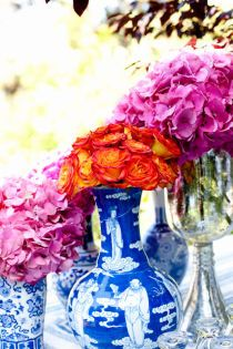 loving the blue and white chinese vases with bright colored flowers