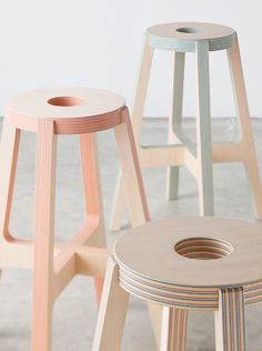 Paper-wood stool by Drill Design. The stool is made of wood-veneers laminated with alternating layers of coloured paper, resulting in a striped effect.