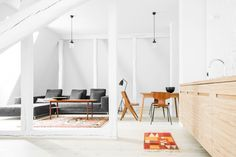 This minimal loft near Berlin is a nice example of minimalism. I like that the walls and floor are white. The all white palette allows