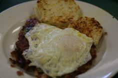 """The """"Mess"""" found at DK Diner; corned beef hash with two eggs, onions and peppers served with a biscuit, located in Columbus, Ohio"""