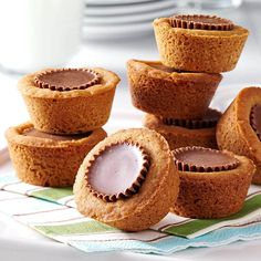 Peanut Butter Cookie Cups I'm a busy schoolteacher and pastor's wife. I wouldn't dare show my face at a church dinner or bake sale without these tempting peanut butter treats. They're quick, easy to make and always a hit. Bake Sale Treats, Bake Sale Recipes, Baking Recipes, Cookie Recipes, Dessert Recipes, Dessert Ideas, Cookbook Recipes, Bake Sale Cookies, Baking Substitutions