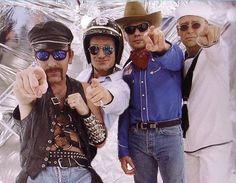 U2 dressed as YMCA guys. Gotta love Larry.