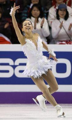 Mao Asada - white feathered dress with swarovski covered net sleeves