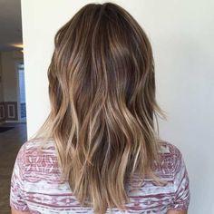 medium layered haircut with balayage highlights