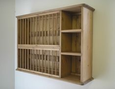http://www.remodelista.com/products/country-pine-universal-wall-plate-rack/