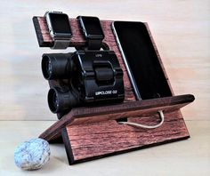 This Simple Docking Station was created so that you can keep several things at one place: cell phone, wallet, watch, keys, jewelry, accessories, and other small items. Stained and Distressed for a rustic look that accentuates the oak wood grain. Item Features: •Cut out at the