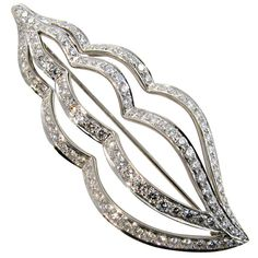 """TIFFANY & CO. chic platinum and diamond """"conch"""" shell brooch. at 1stdibs"""