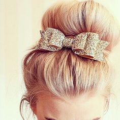 Gold sparkly bow.