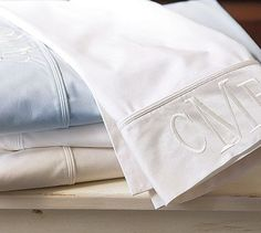 Love the monogrammed sheets at Pottery Barn.