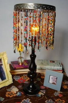 Bohemian beaded lamp DIY. Part old jewlery, part old lamp. What if you used ribbon, or junk jewlery also in one tone, like 'pearls' or 'jade' type jewlery!