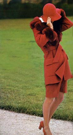 Photo by Peter Knapp Vogue Italia 1973 persimmon red brown suit outfit jacket skirt hat shoes matching 70s designer couture vintage fashion fur model magazine ad