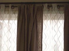 Embroidered Sheers with drapes on double rod in front of sliding glass doors