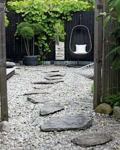 Modern Backyard Garden Ideas To Help You Design Your Own Little Heaven Near Your House Landscape Architecture, Landscape Design, Black Fence, Black Garden Fence, Modern Backyard, Stone Backyard, Nice Backyard, Rustic Backyard, Garden Spaces