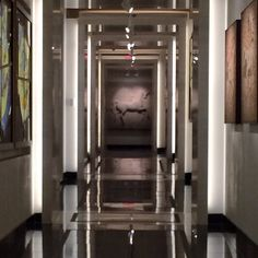 @asid_hq who said hallways had to be boring. This one is transformed to a glossy runway with fine art. #spacematters  #WID2014 | courtneypricedesign