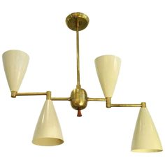 Two Mid-Century Modern Brass and Enamel Articulating Chandeliers | 1stdibs.com