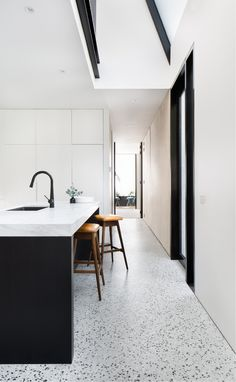 A black and white kitchen with matt polished concrete floors Photography by Emily Bartlett Polished Concrete Kitchen, Concrete Kitchen Floor, White Kitchen Floor, Polished Concrete Flooring, Terrazzo Flooring, White Concrete, Kitchen Flooring, Neutral Kitchen, Home Decor Kitchen
