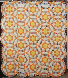 Star wedding ring quilt:  http://quiltinspiration.blogspot.com/2013/01/quilt-inspiration-wedding-ring-quilts.html