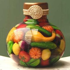 Preserved Fruit Decorative Jar: There are many simple and inexpensive methods of decorating your kitchen and making it a pleasant work place.    Glass bottles and jars of all different
