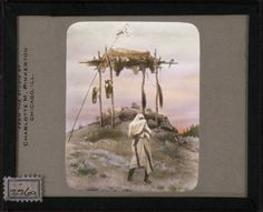 [Platform grave with horse heads, Indian in foreground] McClintock, Walter, 1870-1949.