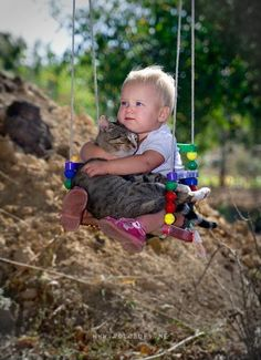 cats seem to tolerate anything babies do to them - so cute