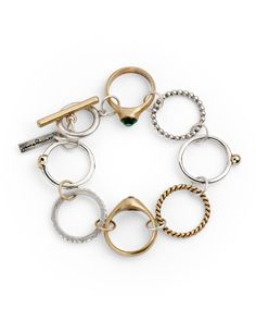 Gather rings that don't fit anymore,connect with jump rings and finish as a bracelet.