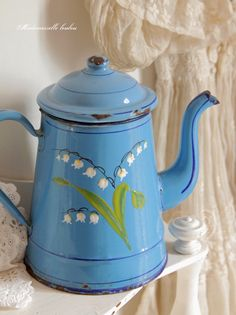 This Lily of the Valley enamel pot is adorable - perfect for displaying in a shabby chic kitchen.