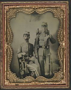 [Two unidentified soldiers in Confederate uniforms with sword, bayoneted musket, and knapsack] (LOC)