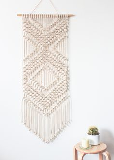 This macrame wall hanging is hand-knotted using 100% cotton cord (braided, 5mm) in natural ecru with a bamboo supporting rod. Approx Dimensions > Bamboo Width: 55cm / 21.5 inches Weaving Width: 45cm / 18 inches Length: 127cm / 50 inches