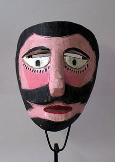 State of Veracruz, Mexico 7.7 inches, carved wood with paint This mask demonstrates typical features of Moor masks from Veracruz-- pink face and dramatic painted sideburns, etc. The exaggerated stub nose and small chin, plus the rounded off corners at the upper back, seem like the work of a particular carver whose uniquely styled masks are found in the region of Carpinteros, but I have not yet discovered his name. Used.