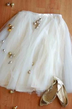 Make a pretty party skirt by sewing tulle onto a thrifted skirt. | 23 Totally Brilliant DIYs Made From Common Thrift Store Finds