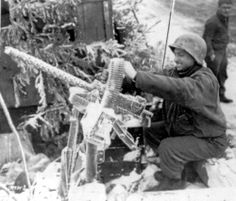 Battle of the Bulge - New Year's Day, snow & frost-covered Browning .30 caliber LMG,  in position near Sourbrodt, Belgium, Jan 1, 1944