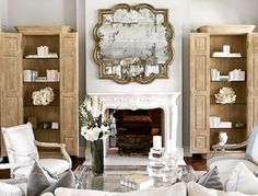 NEUTRAL Collection ~ The Livingroom...perfect shades of neutral color, seating centered on the French inspired fireplace. Antiqued glass mirror, and armoires filled with books and keepsakes. Join us!