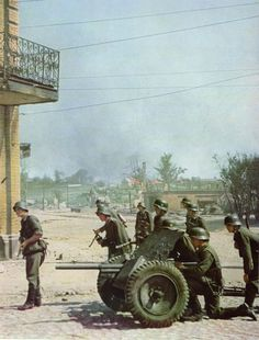 The Pak 35/36 antitank and all-purpose gun was one of the work horses of the German army. Here grenadiers deploy one during street fighting in unidentified Soviet city, 1941.