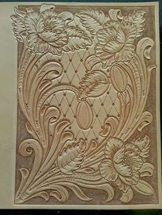 Hand carved leather book cover by Tim Alden. The tooling is done now it is time to line and stitch it together
