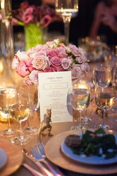 Menu Resting on Pink Flower Arrangement | Photography: Ira Lippke Studios. Read More: http://www.insideweddings.com/weddings/dinosaur-chic-celebration-at-the-american-museum-of-natural-history/571/