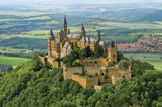 Burg Hohenzollern (Hohenzollern Castle), is the ancestral seat of the imperial House of Hohenzollern.[n 1] The third of three castles on the site, it is located atop Berg Hohenzollern, a 234 m (768 ft) bluff rising above the towns of Hechingen and Bisingen in the foothills of the Swabian Alps of central Baden-Württemberg, Germany|