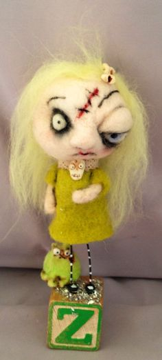 would be a great derby MVP award...  (little zombie girl  and her kitty needle felted art doll Ooak. $59.00, via Etsy.)