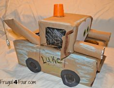 DIY Tow Mater Valentine's Card Box  Start with a shoe box and another small box for the cab and wrapped them in brown packaging paper.