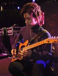 Prince with his favorite guitar.