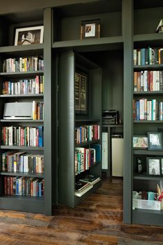 Writer's backyard Studio :: Another section of bookcase opens to a hidden room for copier, fax, mini-fridge, storage, etc. :: pic 4 of 4 Hidden Spaces, Hidden Rooms, Home Library Design, House Design, Floor To Ceiling Bookshelves, Harrison Design, Modern Shed, Backyard Studio, Modern Backyard